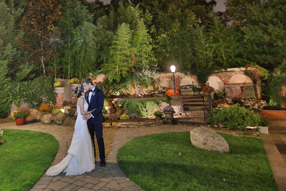 Wedding photo of a newly married couple kissing in outdoor wedding venue in NJ - il Tulipano Piazza